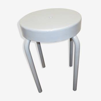 Former industrial stool in metal