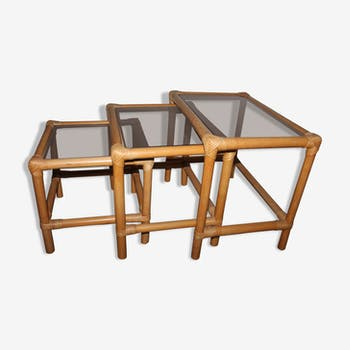 Rattan nesting tables in rattan and smoked glass from the 70s