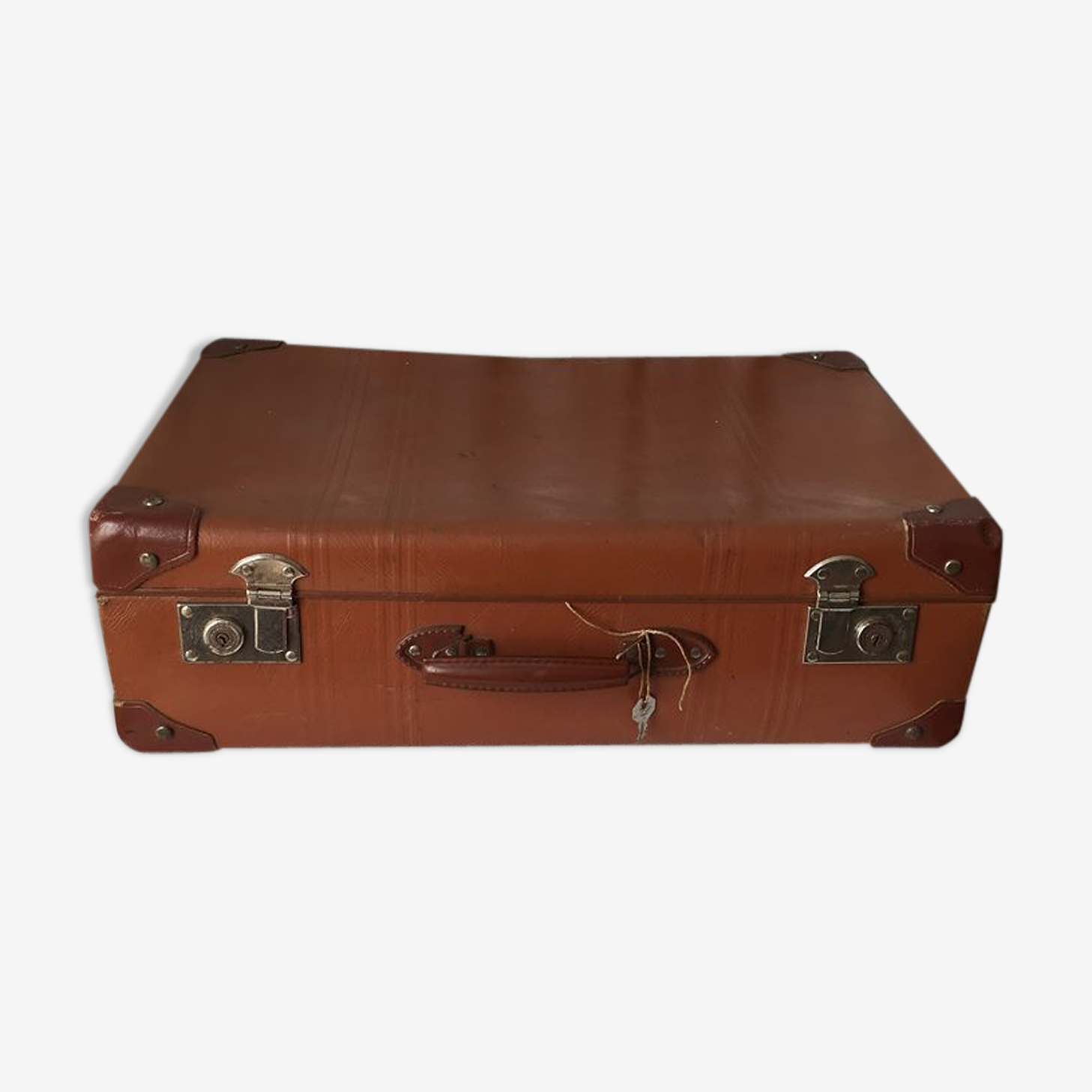 Old brown suitcase.