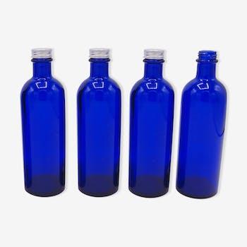 Ensemble de 4 petites bouteilles