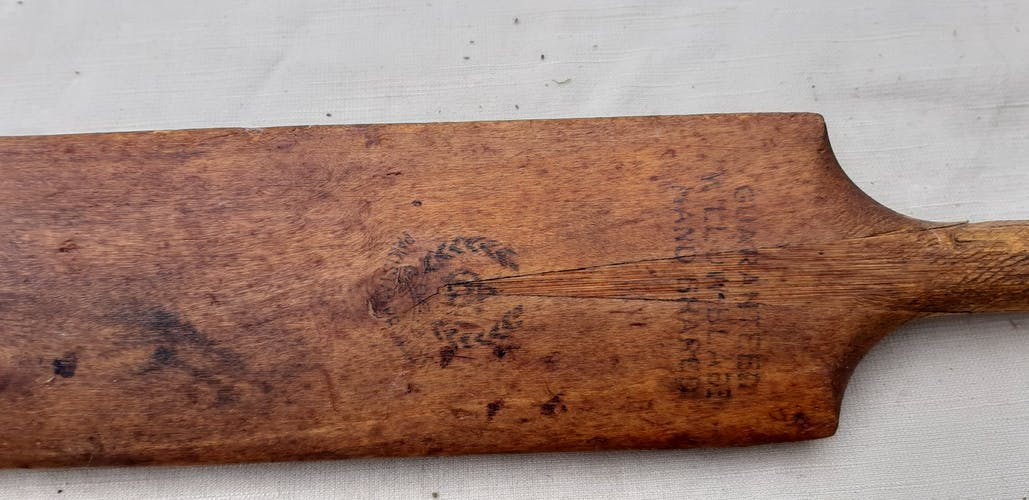 Ancient cricket bat in wood