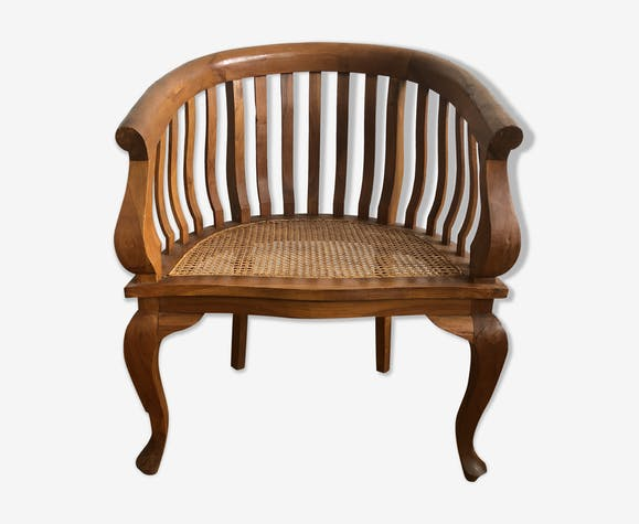Fauteuil colonial canné en bois exotique