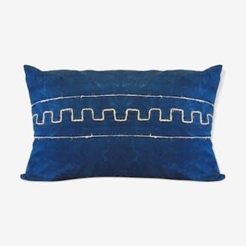 Cushion has Greek metis tie and dye pattern