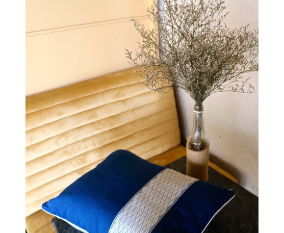 Blue and white two-tone graphic cushion