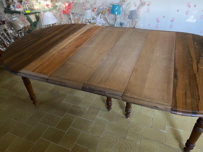 Table ronde à volet et 8 rallonges en chêne