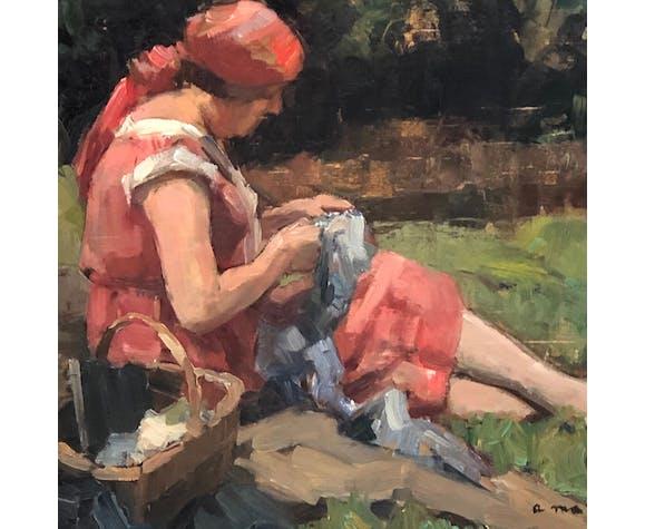 Une femme assise dans son jardin