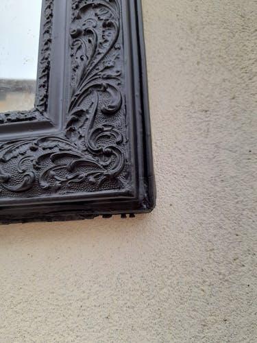 Miroir Louis Philippe patiné en noir  63x90cm