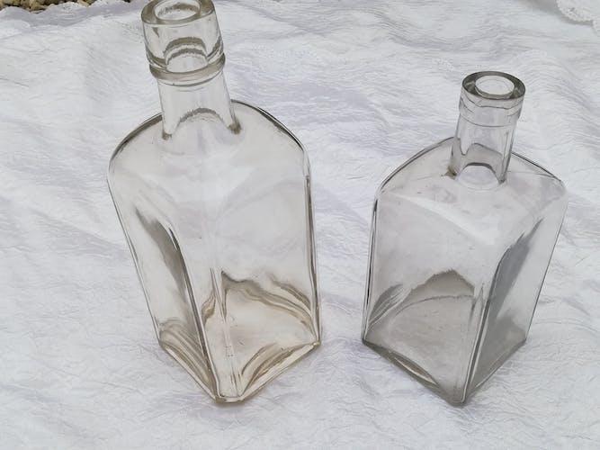 Two transparent vials