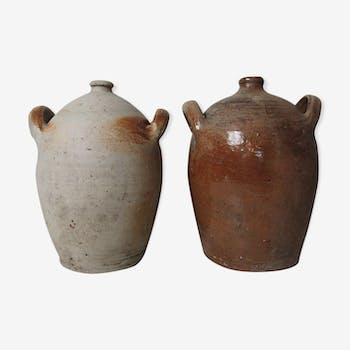 Two old sandstone jars