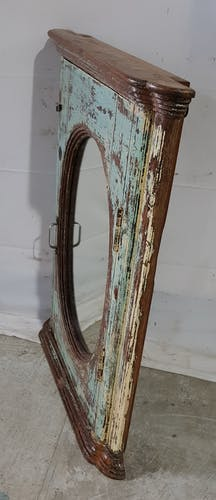 Ancienne fenêtre ovale en teck