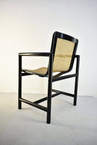 Pair of vintage mid century modernist wooden dining chairs with cane seat produced by Stol in 1970s / 1980s