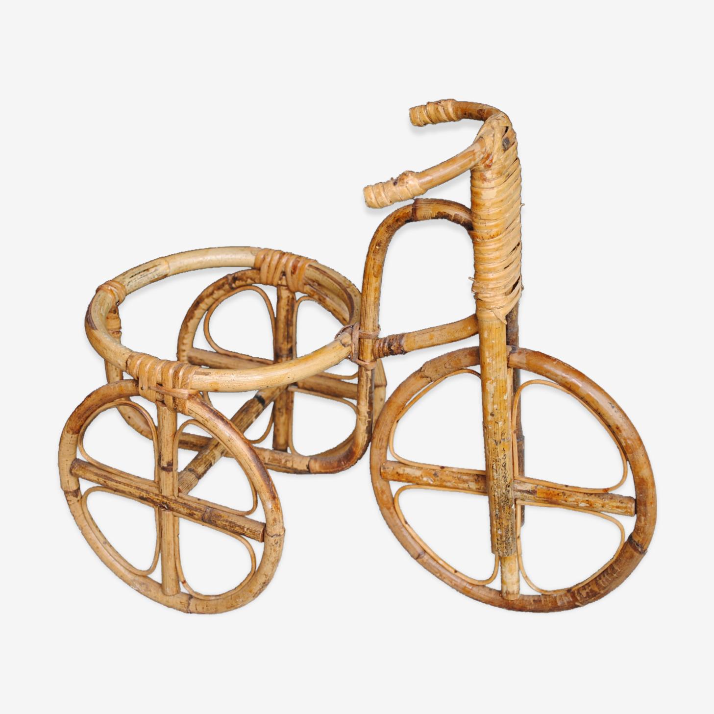 Tricycle porte plante en rotin