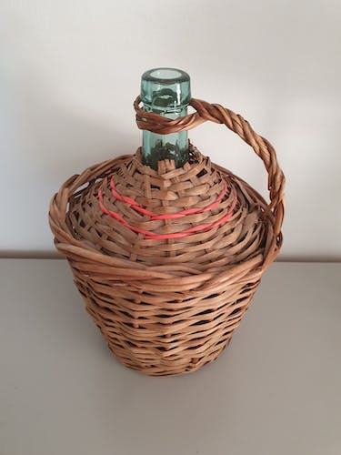Blue demiojohn blue braided wicker green canister