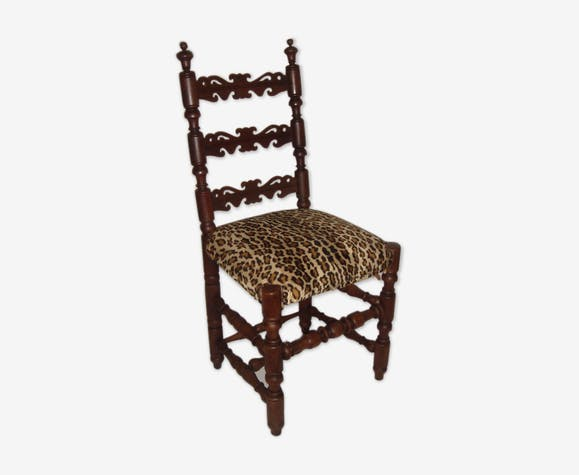 Old chair covered Leopard fabrics