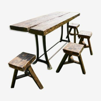 Heavy table with rustic style stools.