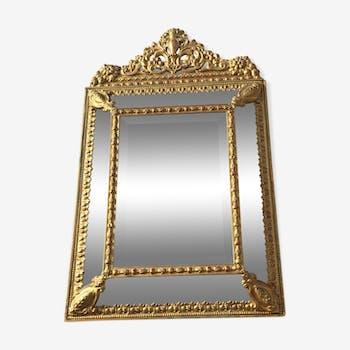 Miroir ancien biseauté à pare closes en bois doré 87x54 cm