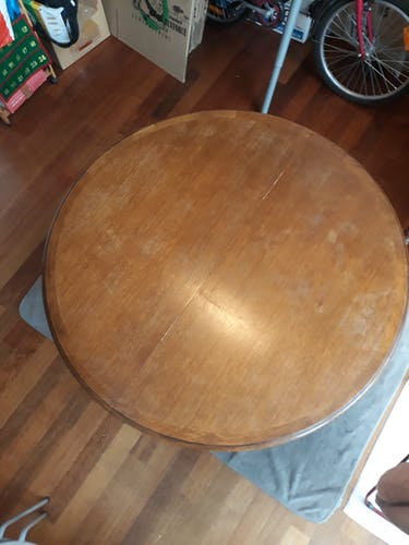 Round cherry table with integrated folding extension