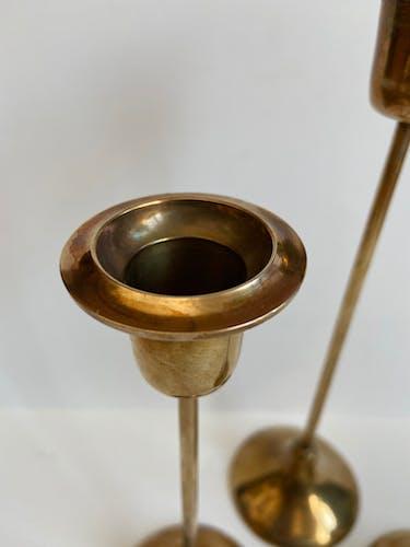 Trio of gold brass candlesticks