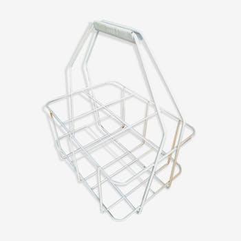 Wine rack in white metal shopping cart