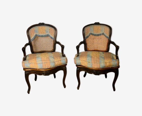 Convertible armchairs Louis XV era in walnut moulded and cannes