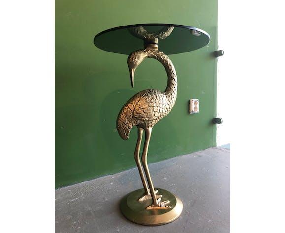 Table en verre ronde  avec la grue comme base