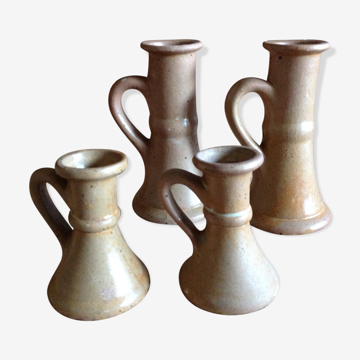 Set of 4 candlesticks in sandstone
