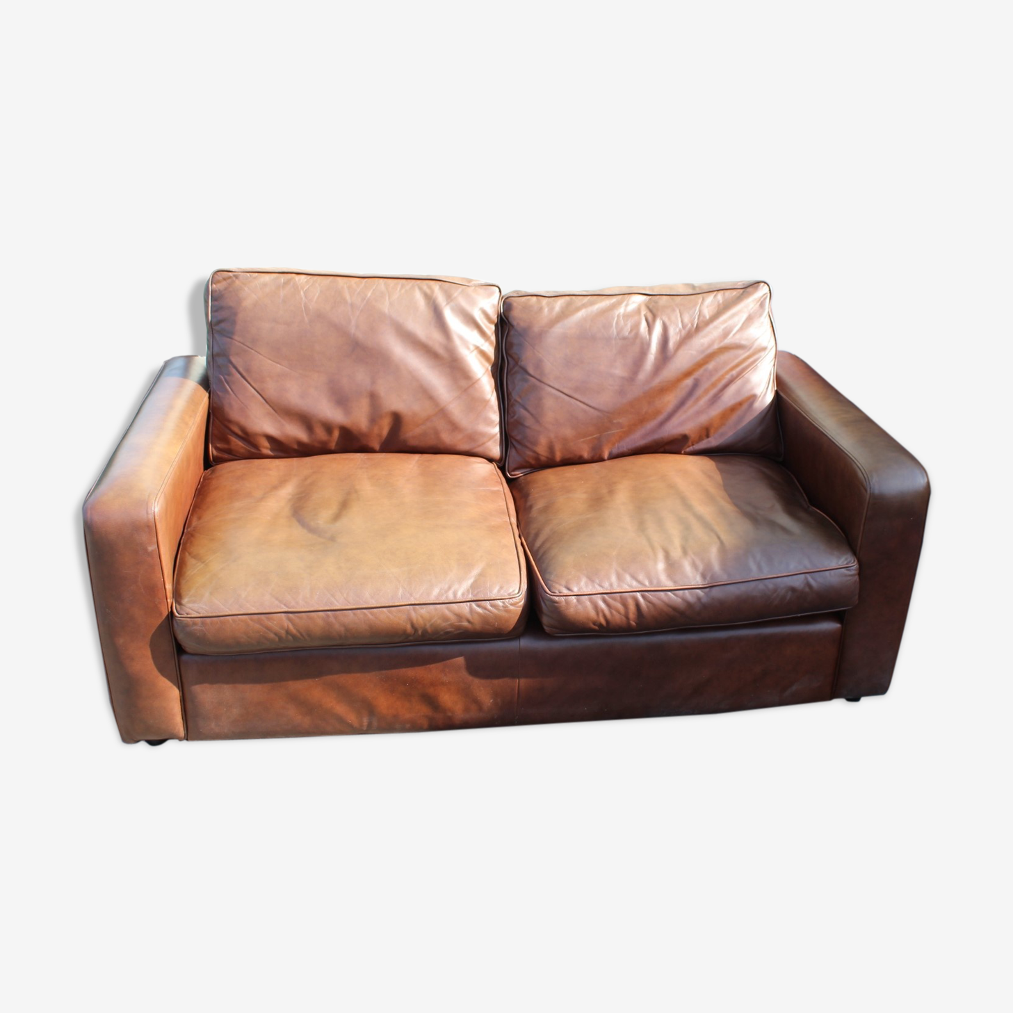 Two seater light brown sofa