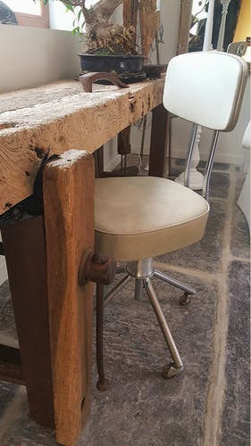 Chaise industrielle d'atelier sur roulettes