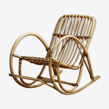 Vintage child's rocking chair in rattan or cane