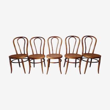 Suite de 5 chaises bistrot caramel cannées années 70