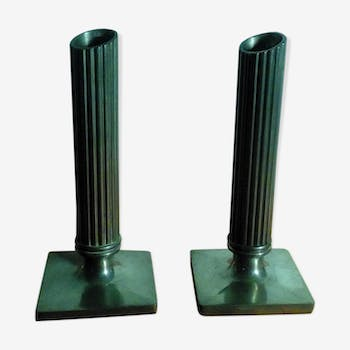 Pair of silver metal candlesticks by Guy Degrenne