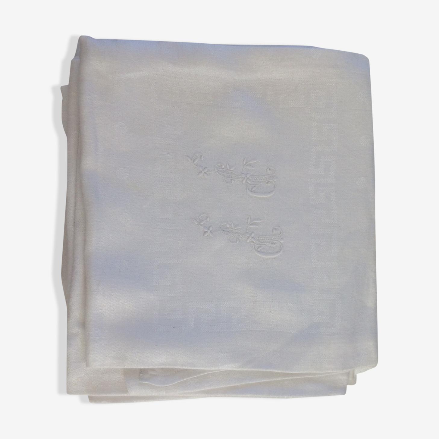 Lot de 8 serviettes damassées avec monogrammes.