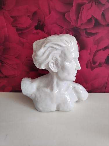 Bust of J. Mermoz in white cracked ceramic by H. Laurens