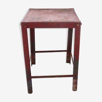 Workshop in red metal stool