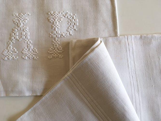 pair of AP monogram towels in cold linen