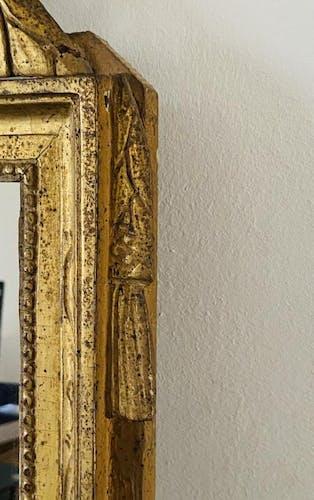Miroir en bois sculpté et doré d'époque Louis XVI 67x39cm
