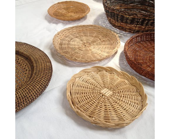 Wall composition of seven baskets and wicker trays