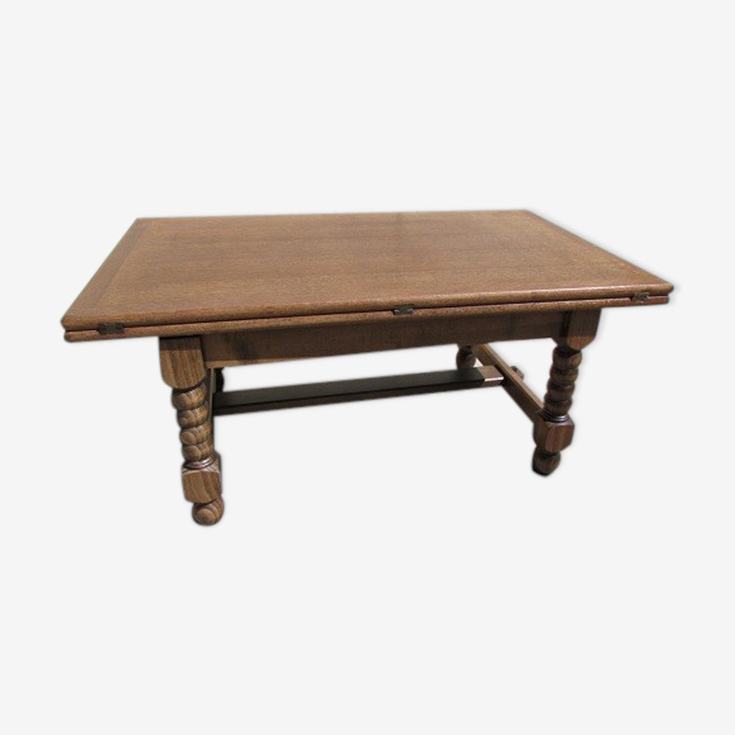 Table basse porte-feuille à système