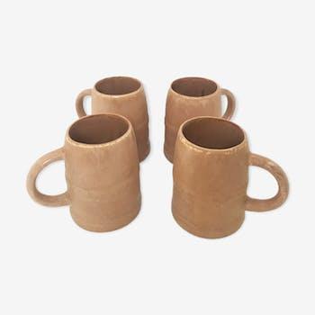 4 sandstone mugs, 1970
