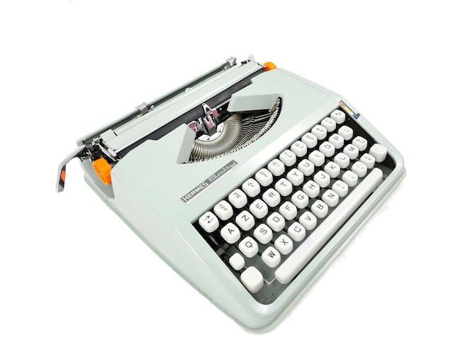 Machine à écrire Hermes Baby Cursive vert tilleul