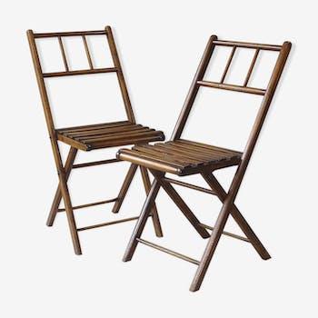 Paire de chaises pliantes lattées vers 1950