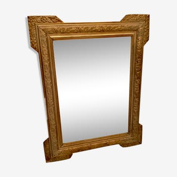 Wooden mirror and golden stuck