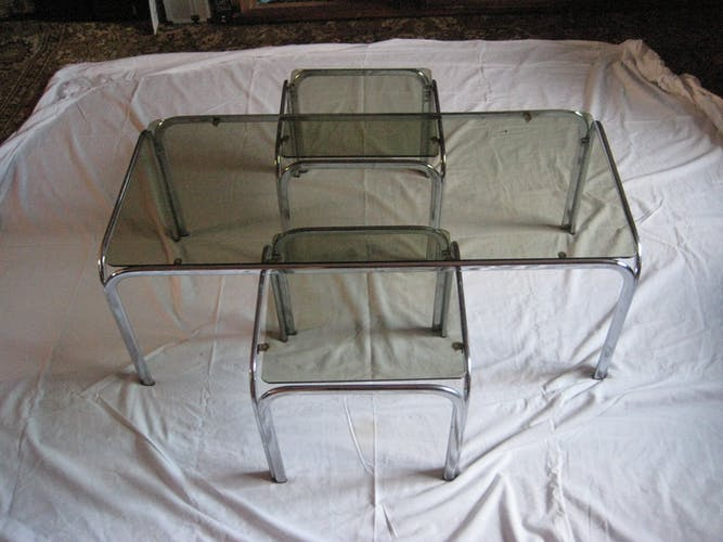 "Great tables ""pull-out"" design ""70"", base chrome, glass smoked, TBE!  All metal and chrome parts were pases in the Mirror! A few bites of rust due to the time, but ""almost"" impercercetibles! TBE!"