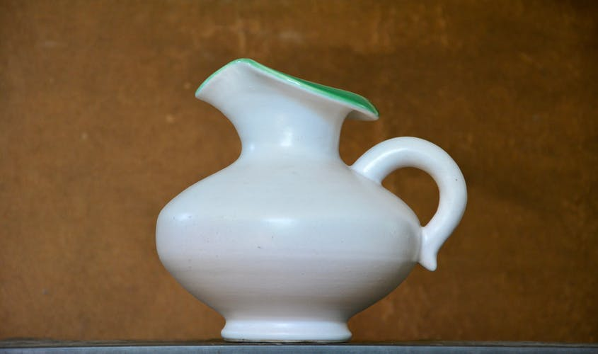 White and green pitcher by Pol Chambost