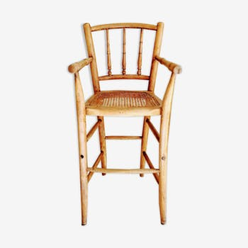 High curved wooden chair