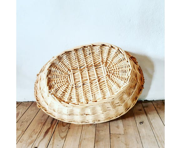 Vintage pan with two handles made of raw wicker