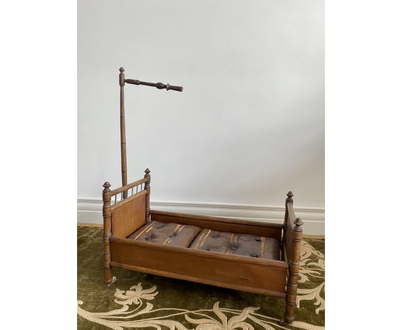 Antique wooden doll bed, sold by Au bon Marche