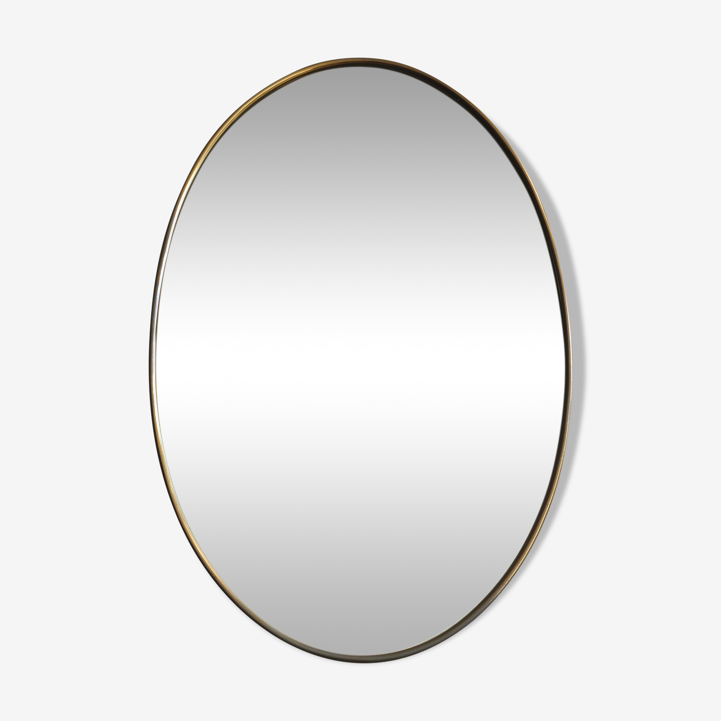 Mirror oval brass of the 1960s 36x56cm