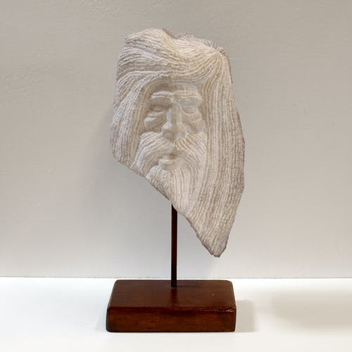 Carved stone head sculpture