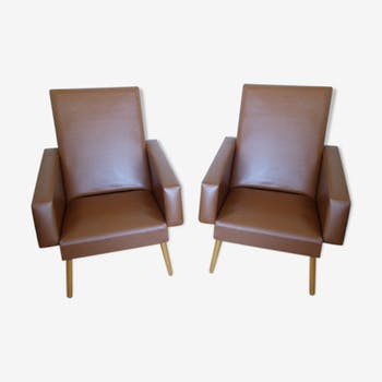 Pair of vintage brown synthetic leather armchairs